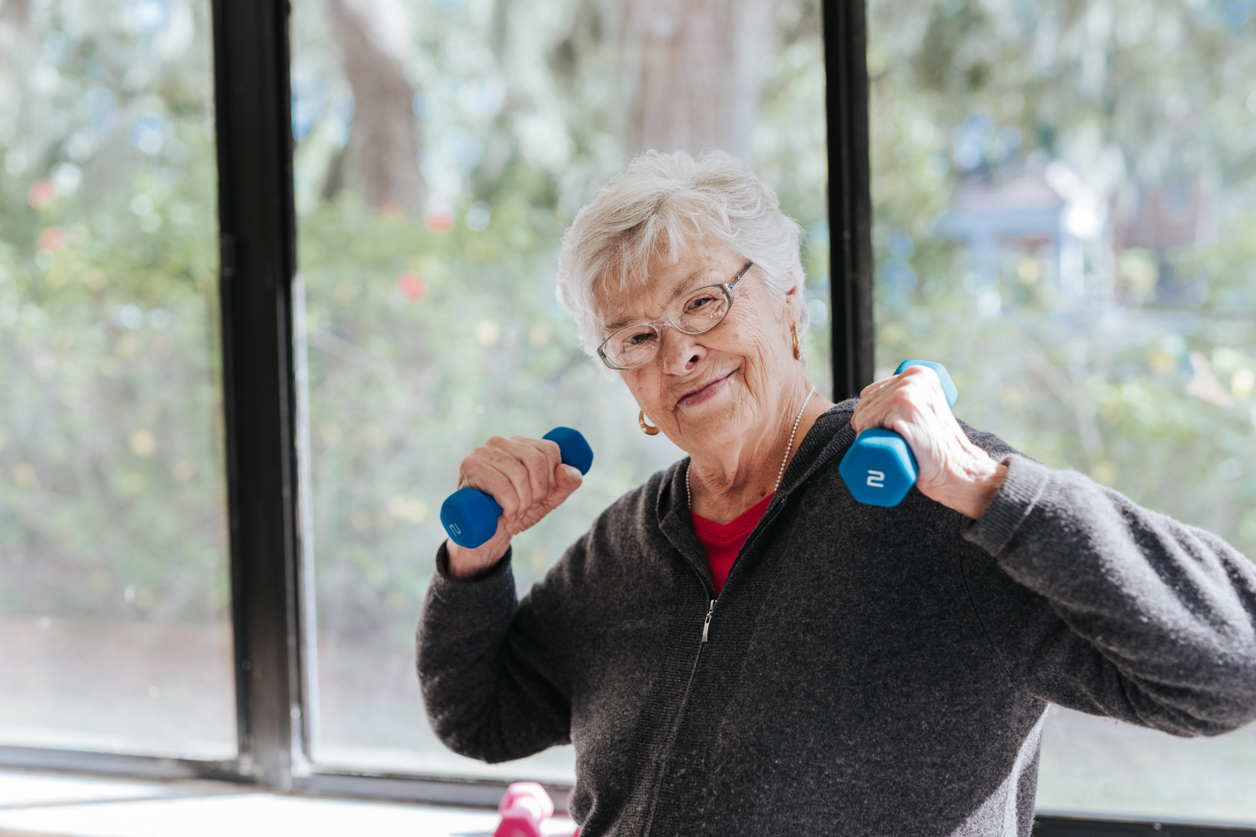 Senior Woman Holding Dumbbells
